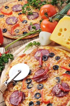 diferent: fresh baked pizza with  diferent ingredients