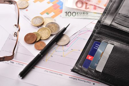 diagramme, credit cards and purse on  table photo