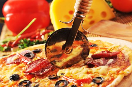 Close up of  pizza with tomatoes, cheese, black olives and  peppers. Stock Photo - 6238920