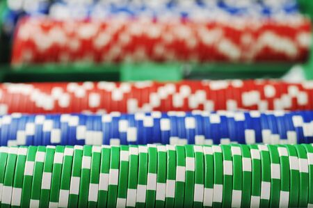 different color chips for gamblings on green background.  photo