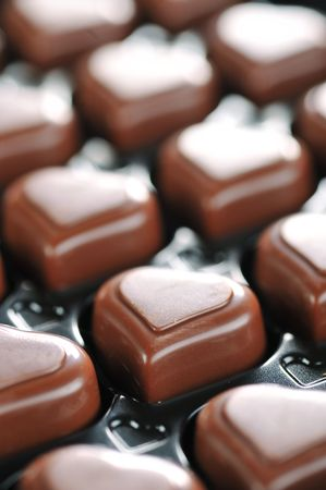 box of chocolates: Heart shape delicious chocolate in box  close-up Stock Photo