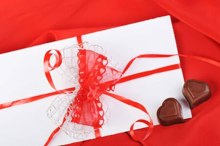 chocolate and letter on red close up photo