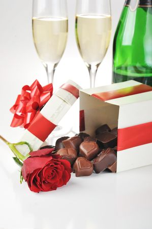 beautiful red rose, champagne  and chocolate  close up photo
