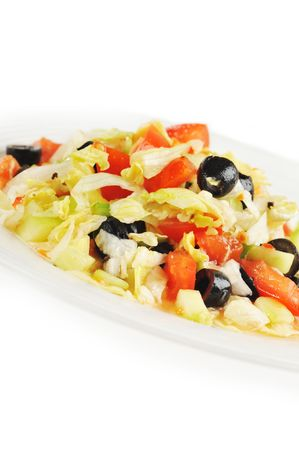 Tasty salad from vegetables on white plate Stock Photo - 6320083