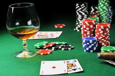 Cigar, chips for gamblings, drink and playing cards on green Stock Photo - 6320553