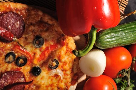 Tasty pizza  and various vegetables close up photo
