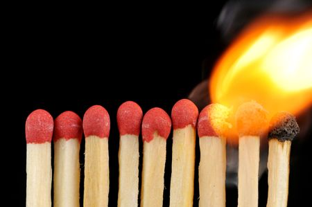 sulphur: row of matches, with one of them burning