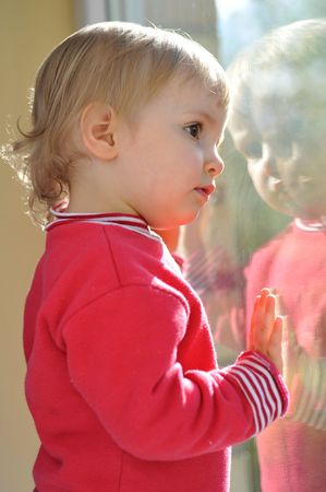 little girl looking at her reflection in  mirror Stock Photo - 6420759