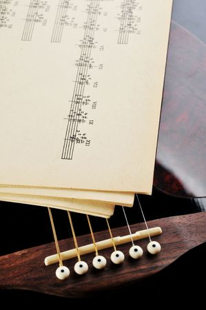 acoustic guitar and sheet music photo