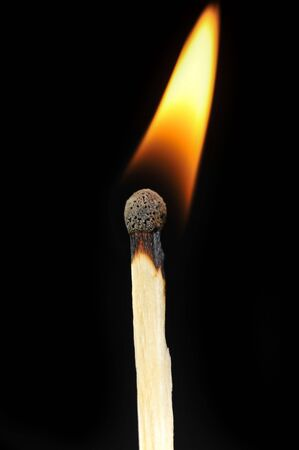 ignited:  ignited matchstick flame in dark close up Stock Photo