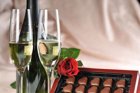 Heart shape chocolate, champagne  and red rose  photo