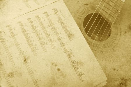 Old acoustic guitar and sheet music photo