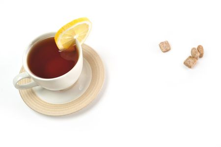 cup of tea with lemon, pastry  and sugar photo