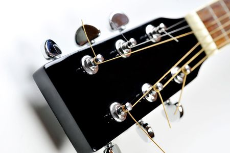 headstock of acoustic black guitar close up photo