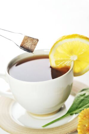 cup of tea with lemon and sugar photo