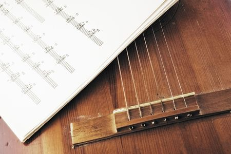 frets: Old acoustic guitar and sheet music