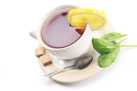 full cup of tea with lemon and sugar Stock Photo - 6492139