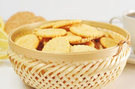 cup of tea with lemon, pastry  and  cookies in  basket photo