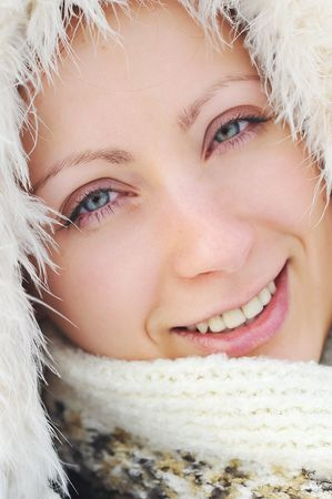 pretty young woman wearing winter outfit with fur portrait Stock Photo - 6510707