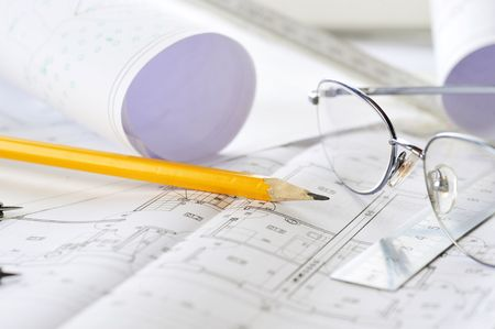 Ruler, eraser, glasses and a pencil on the floor plan - Bussines a still-life  photo