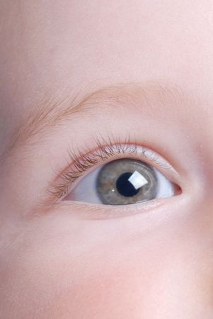 with blue eyes: beautiful baby eye close up
