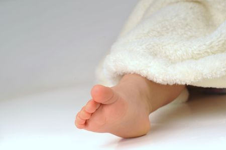 feet of  little girl in  white towel photo