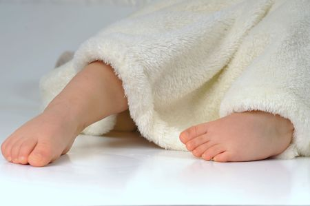 feets of  little girl in  white towel photo