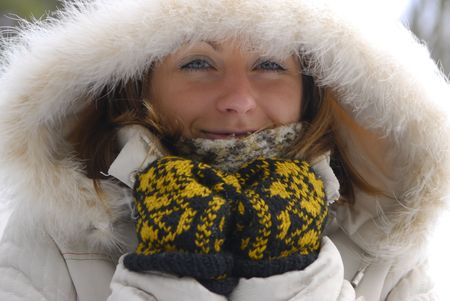 girl wearing winter coat with hood photo