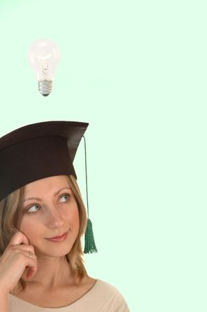 alumna: young girl with bachelor cap thinking Stock Photo