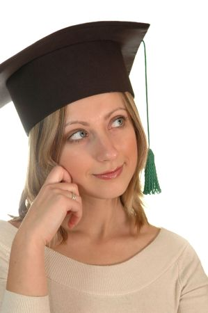 baccalaureate: young girl with bachelor cap thinking Stock Photo