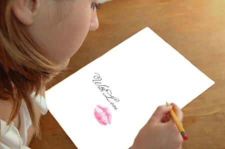 rubber sheet: young woman with pencil writing on paper Stock Photo