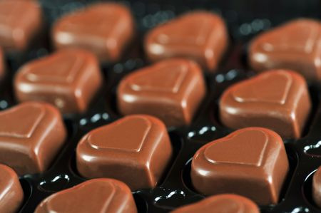 Heart shape delicious chocolate in box  close-up photo