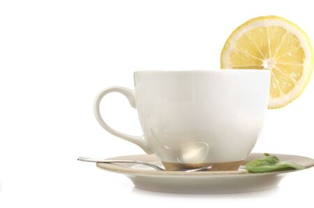 full cup of tea with lemon and sugar photo
