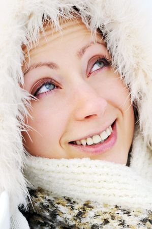pretty young woman wearing winter outfit with fur portrait photo