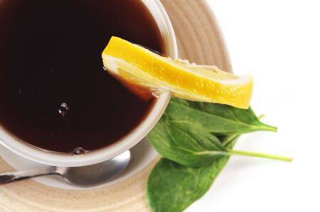 full cup of tea with lemon Stock Photo - 6625514