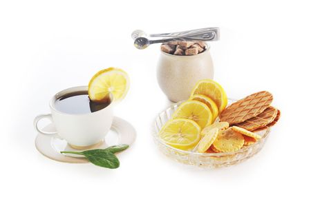 cup of tea with lemon, pastry  and sugar Stock Photo - 6682659