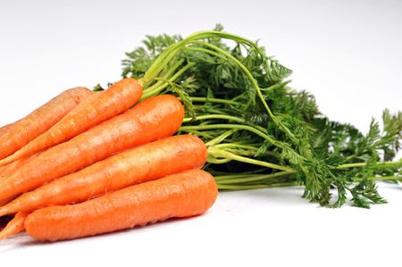Bunch of fresh carrots with leaves  on white background photo