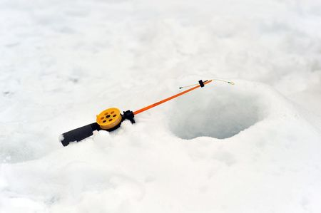 Fishing line in  hole drilled in ice Stock Photo - 6684317