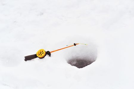 Fishing line in  hole drilled in ice Stock Photo - 6683390