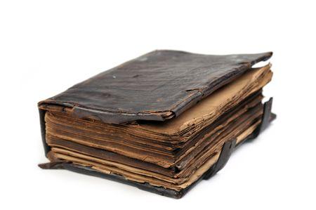 oud document: echt oud boek geïsoleerd op een witte achtergrond. Stockfoto