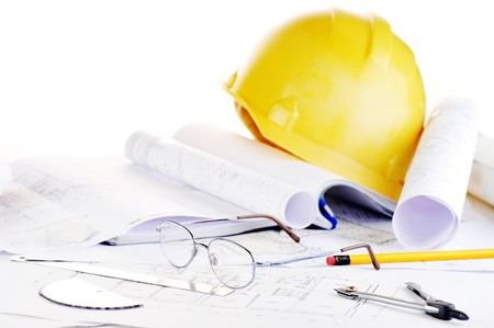 architect tools: Yellow helmet and heap of project drawings Stock Photo