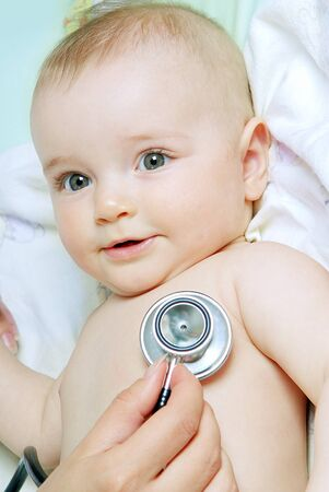 doctor exams baby with stethoscope Stock Photo - 6954997