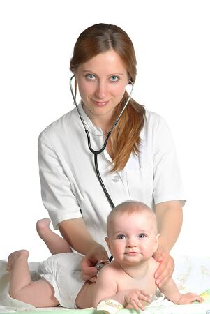 woman doctor exams baby with stethoscope photo