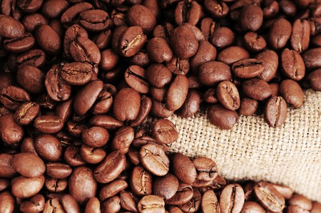 Many coffee grains on rough fabric Stock Photo - 7128707