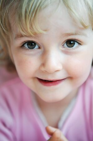 Portrait of lovely blond little girl photo