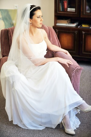 beautiful stylish bride in  white dress in  room Stock Photo - 7319137