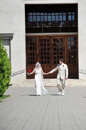 Newly wed couple  go on sidewalk for church Stock Photo - 7318870