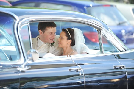 newlywed couple, groom  and bride,  in car Stock Photo - 7318940
