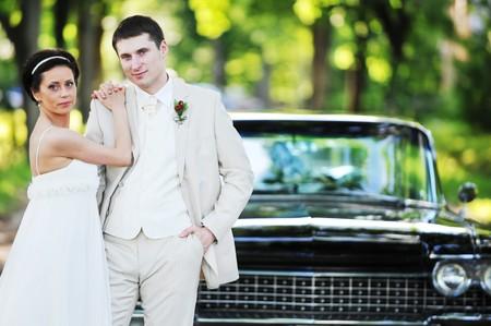 Wedding couple near  car  after their wedding ceremony photo