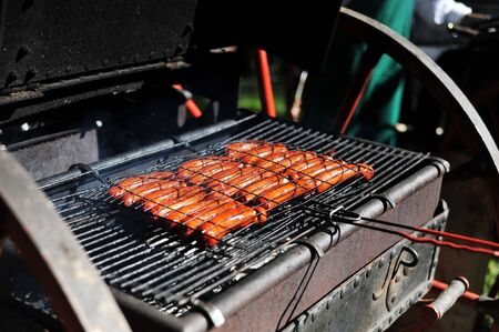meat sausages cooking on  grill photo